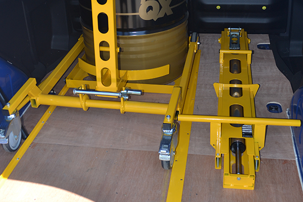 A transfer handle for raising the load, transferring it to and from the bulkhead for safe and multiple loading of goods.